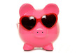 piggy bank wearing heart shape glasses
