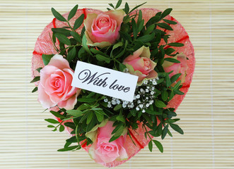 With love note on pink roses bouquet