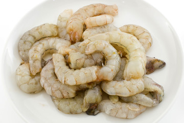 Fresh peeled uncooked shrimp harvest isolate white background