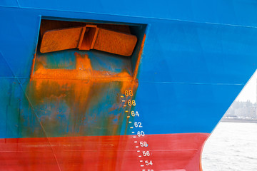 Ship with draft scale and rusty anchor on the bow