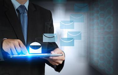 businessman hand pressing e-mail sign as concept