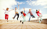 Fototapety group of teenagers jumping