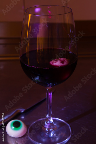 canvas print picture Halloween eyes in a redwine glass