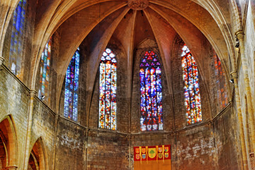Stained-glass window in old  Catholic temple. Spain.