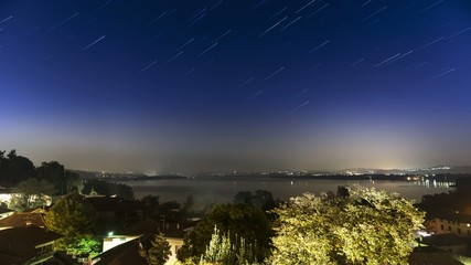 Varese lake, star trails in a summer night