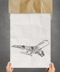 hand drawn airplane on crumpled paper background