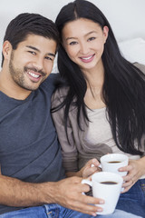 Asian Chinese Couple Drinking Tea or Coffee at Home