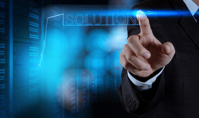 businessman hand pushing solution graph on a touch screen interf