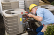 Mature Repairman works On Apartment Air Conditioning Unit - 71557320