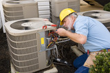 Mature Repairman works On Apartment Air Conditioning Unit