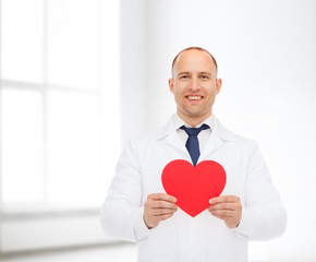 smiling male doctor with red heart