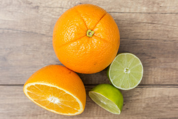 Orange And Lime Citrus Fruits On Wood Table