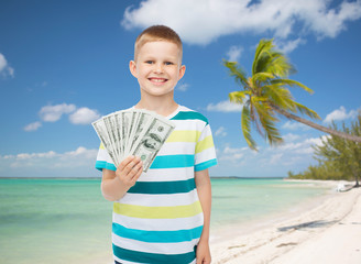 smiling boy holding dollar cash money in his hand