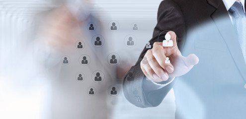 hand choosing people icon as human resources concept