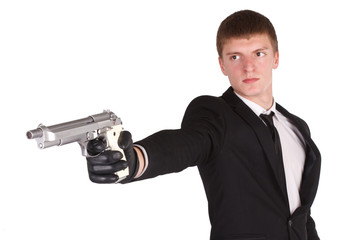 man in black costume and handgun