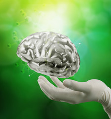 doctor neurologist hand show metal brain with green background a