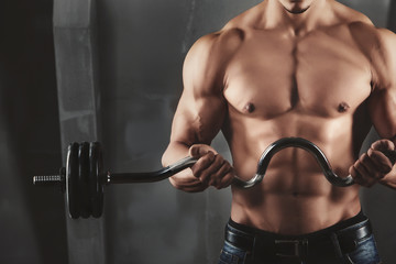 Close up of young muscular man lifting weights © BestForYou