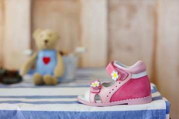 Baby Shoes. Pink baby shoes on white blue background.