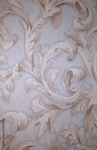 Vintage grey victorian wallpaper with beige baroque vignette © Inna Felker