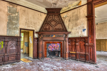 Massive fireplace in an abandoned mansion