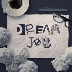 hand drawn design words DREAM JOB on crumpled paper background a