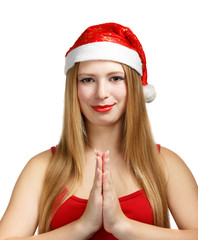 Young woman in santa hat makes a wish