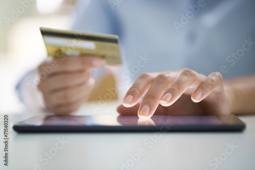 Fototapeta Woman is shopping online with digital tablet
