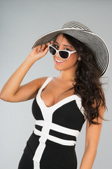 Attractive young woman with straw hat and sunglasses