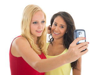 Girlfriends taking selfie