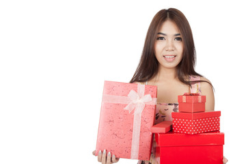 Beautiful Asian woman hold many red gift boxs