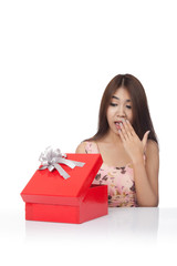 Beautiful Asian woman surprised open a  red gift box