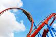 Leinwanddruck Bild - Roller Coaster in funny amusement  park