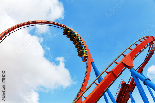 Leinwanddruck Bild Roller Coaster in funny amusement  park