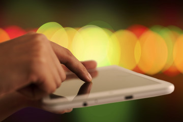 Tablet and Colorful Bokeh Background