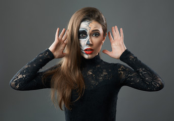 Surprised woman with makeup skeleton