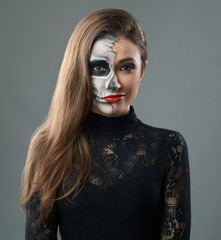 woman with makeup skeleton grins