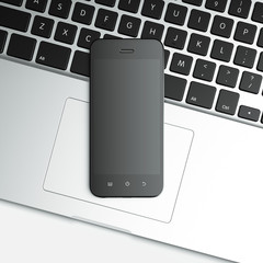 blank mobile smart phone on the laptop