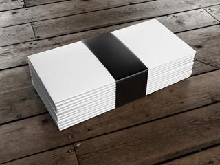 stack of envelopes on wooden floor