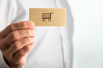 Man holding a business card with a shopping icon