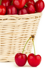 Close up to a red cherries in a basket