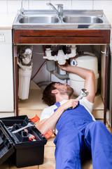 Man repairing kitchen sink