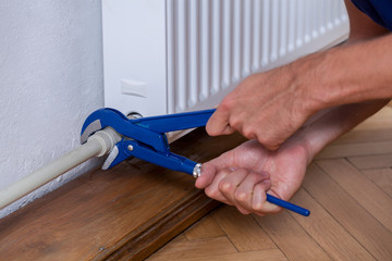 Male hands repairing radiator