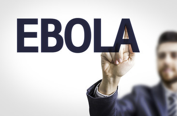 Business man pointing to transparent board with text: Ebola