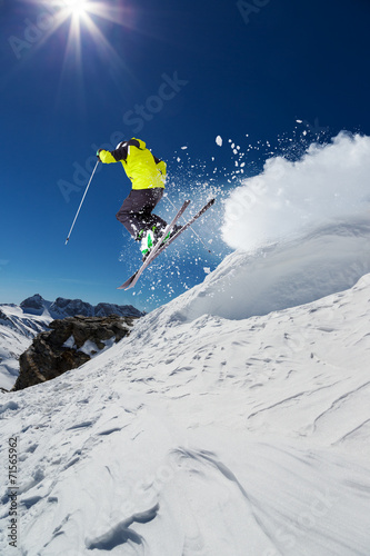 canvas print picture Alpine skier jumping from hill