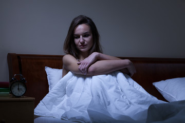 Woman staying awake at night