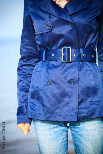 canvas print picture Female fashion. Closeup blue coat wit belt