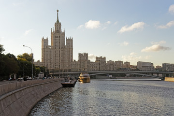 Moscow city center highrise tower on the sunrise and yacht saiMo