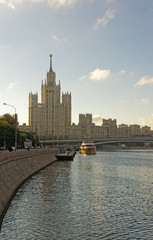Moscow city center highrise tower on the sunrise and yacht saili