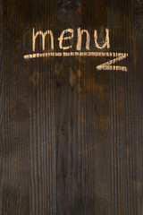 Inscription menu on wooden board close-up