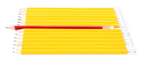 One red pencil standing out from others, isolated on white